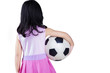 Back side of little girl holding a ball