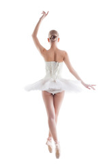 Rear view of slender young ballerina in tutu