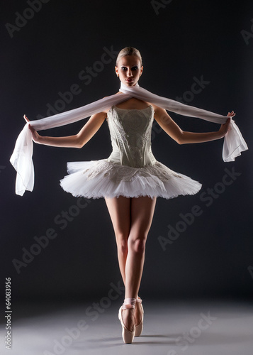 Graceful ballerina dancing looking at camera