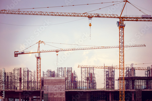 Construction site with cranes and scaffolding