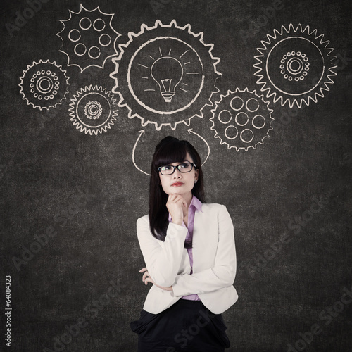 Businesswoman with mechanisms gear