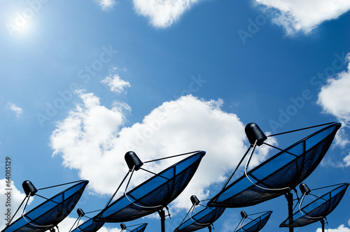 black antenna communication satellite dish on blue sky