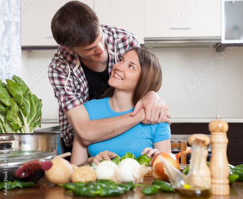 Loving couple cooking