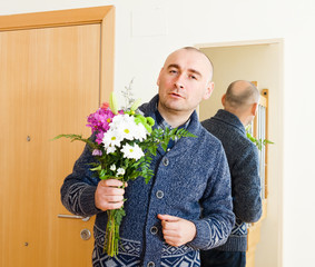 guilty man with   bouquet