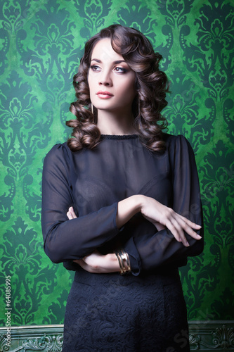 Sensual woman in green vintage interior