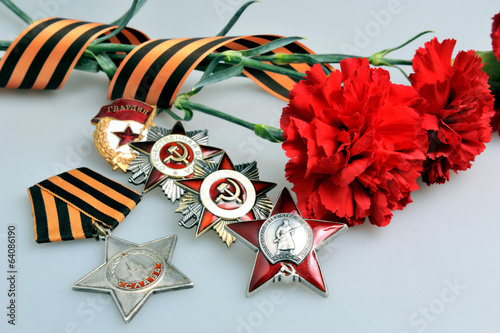 Flowers tied with Saint George ribbon, orders of Great patriotic