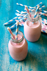 Strawberry smoothie with colorful paper straws