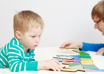 child playing with puzzle, early education concept