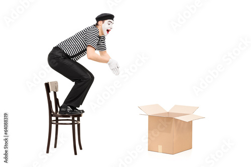 Mime artist jumping in an empty box