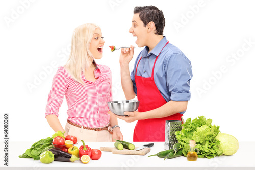 Man and woman enjoy cooking together