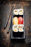 Fototapety sushi with chopsticks