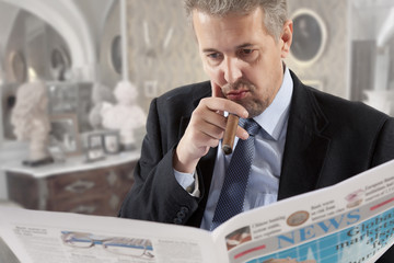 Businessman reading a newspape