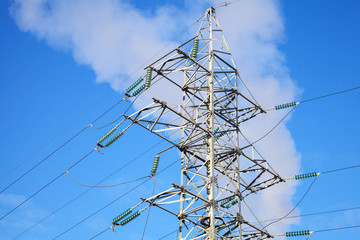 High voltage power lines and steel pylon above the sky