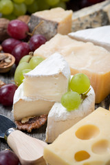 assortment of cheeses and grapes, close-up