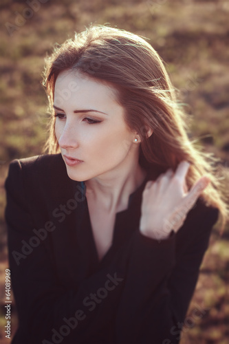 Young woman outdoor emotional portrait