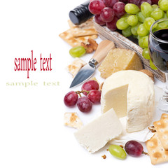 assortment of cheeses, red and green grapes, crackers and wine