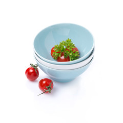clean bowl, cherry tomatoes and parsley, isolated