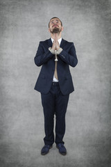 Arrested businessman praying