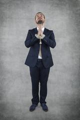 Arrested businessman praying