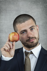businessman holding an apple in hand