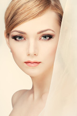 Beautiful girl with a white veill,  on a light  background