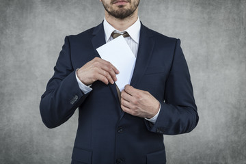 businessman hiding his bribes