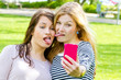 Girls making a funny selfie