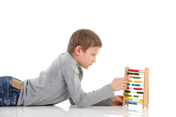 Schoolboy using an abacus