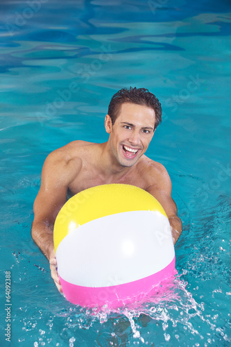 Man with water ball playing in pool
