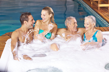 Two couples having fun in whirlpool