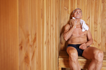 Old man relaxing in sauna