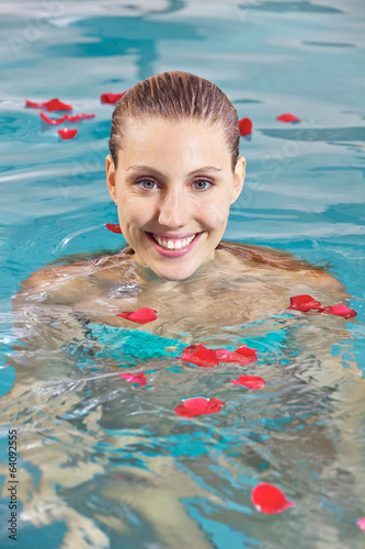Woman in pool with leaves of roses
