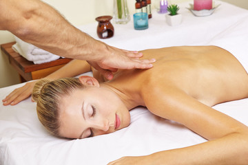 Woman in day spa receiving thai massage