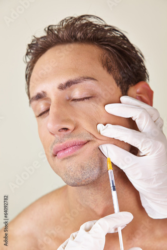 Man getting syringe against wrinkles