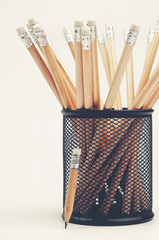 Wooden pencils in a metal stationery