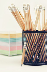 Wooden pencils in a metal cup
