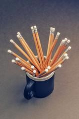 Wooden pencils in a black mug