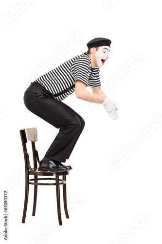Male comedian jumping from a chair