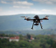 flying drone with camera on the sky - 64094737