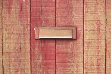 Letterbox and wooden door