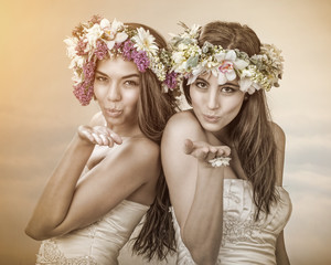 Two beautiful spring fairy , brides sending a kiss to you