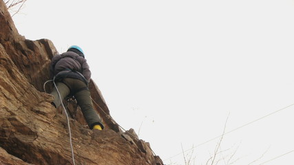 Climber training in the vertical wall