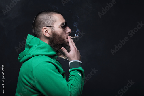 Bearded man, smoking