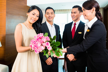 Asian Hotel Manager welcoming guests
