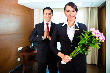Asian Hotel Manager with flowers