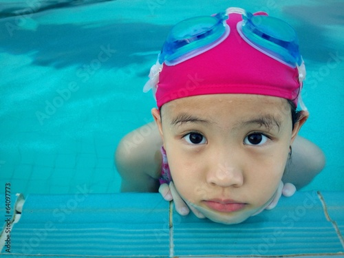 Asian girl in the pool