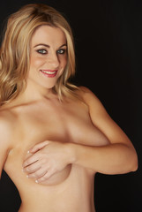 Topless blonde woman