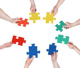 circle of people hands with puzzle pieces