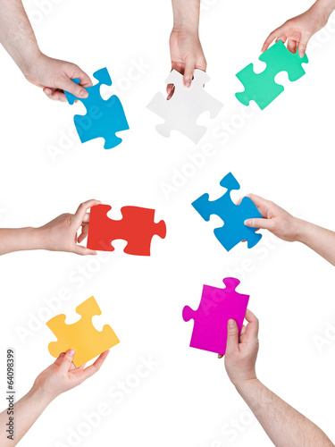 people hands circle with different puzzle pieces
