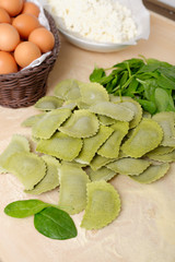 Making home made ravioli with spinach and ricotta filling